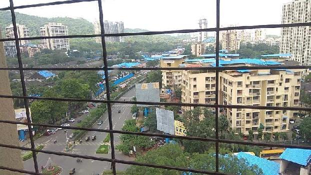 SPACIOUS 2 BHK NEAR DR. KASHINATH GHANEKAR AUDITORIUM, HIGHER (SECOND LAST) FLOOR IN A TOWER.