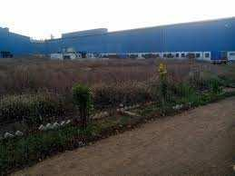 4 Acre Industrial N.A Land with 80000 sq.ft Construction for Sell