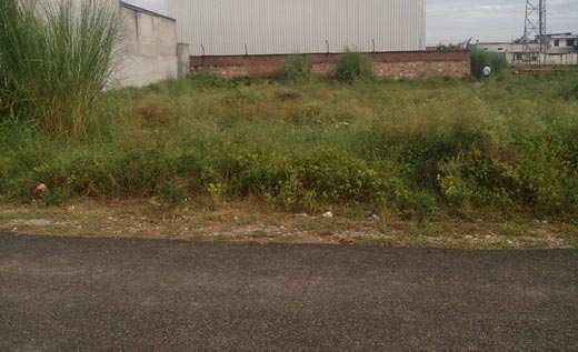 1000 sqmtr Factory plot/ land with 3000 sq ft buiulding