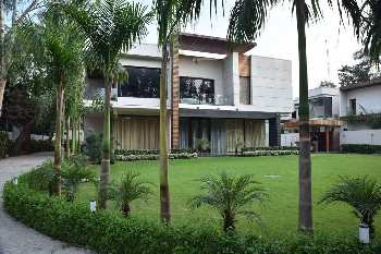 Amidst lush greenery, njproperties.in offers this 5 BHK farmhouse for rent in DLF Chattarpur,