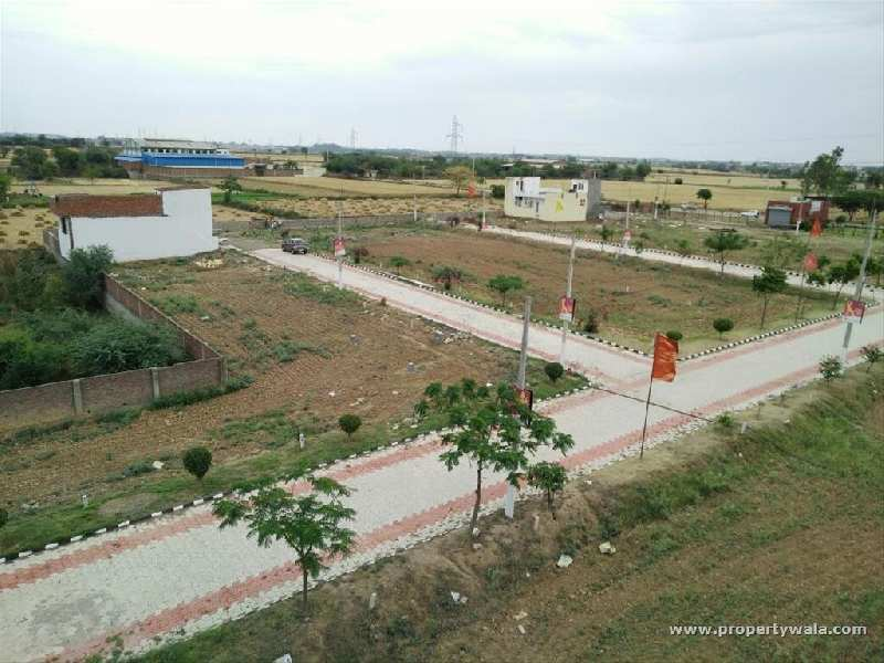 CORNER TWO SIDE OPEN PLOT IN GATED TOWNSHIP